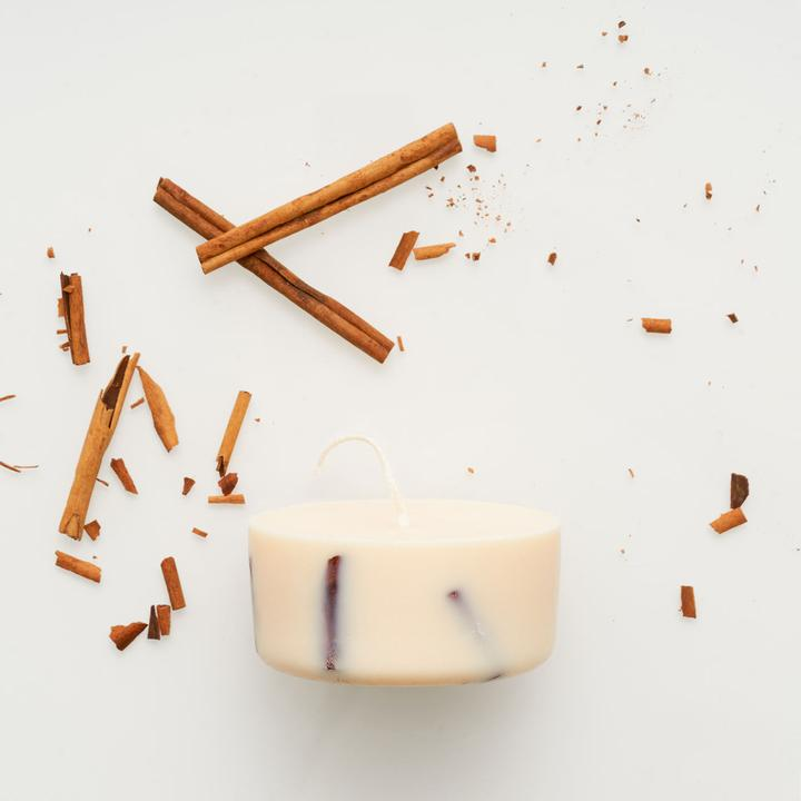 Flat lay picture of handmade cinnamon mini soy wax candle by The Munio, available now at cuemars.com