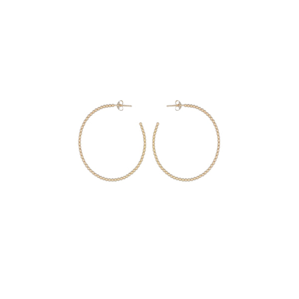 Gold Beaded Hoop Earrings by Corosch | Discover now at Cuemars