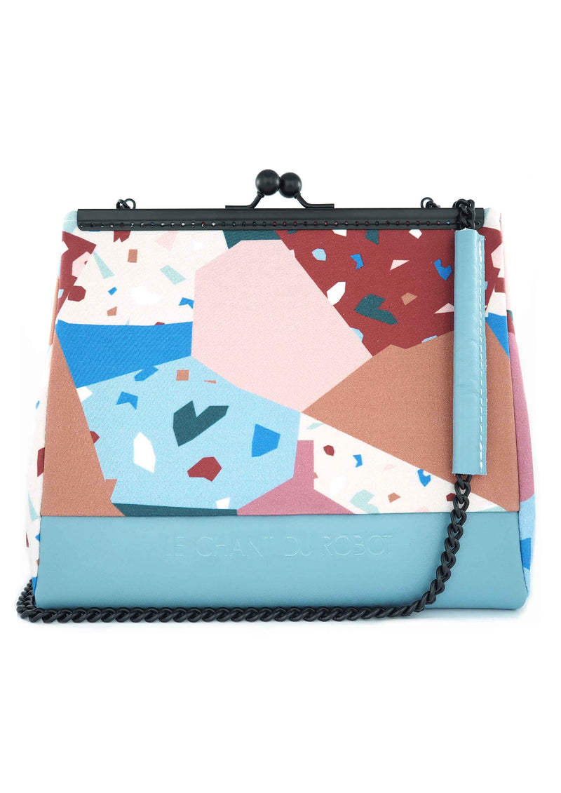The Blue Terrazo clutch is part of a collection of unique handbags by Le Chant du Robot, a French accessories brand by Geoffrey.