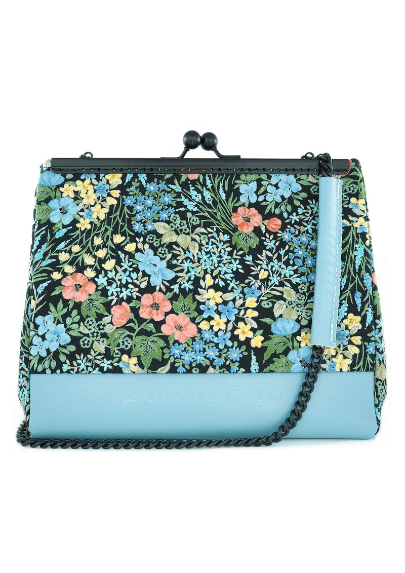 The Blue Wild Flowers clutch is part of a collection of unique handbags by Le Chant du Robot, a French accessories brand by Geoffrey.