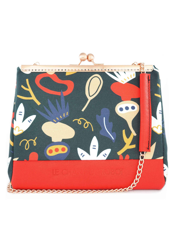 The Red and Blue pattern clutch is part of a collection of unique handbags by Le Chant du Robot, a French accessories brand by Geoffrey.