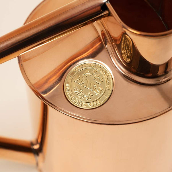 Close up picture of handmade watering can in solid copper by British family business Haws, available to purchase at Cuemars