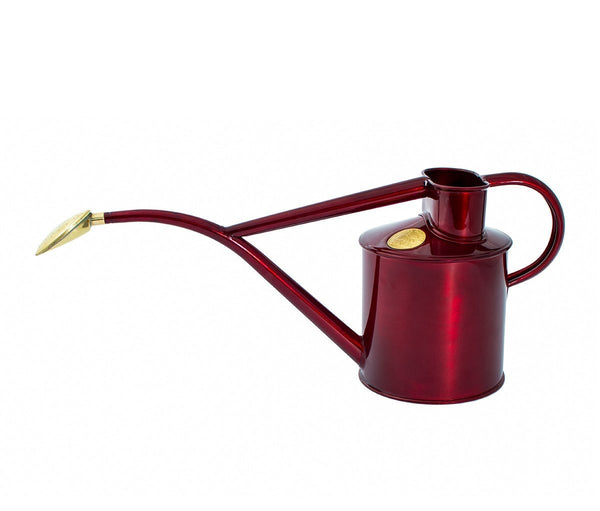 Haws handmade metal indoor watering can in claret with brass rose and Haws emblem in brass
