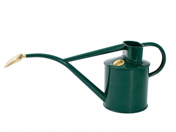 Haws handmade metal indoor watering can in green with brass rose and Haws emblem in brass