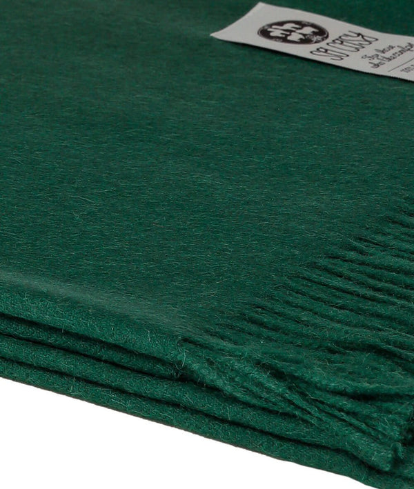 Close up Woven British Racing Green Baby Alpaca soft blanket designed in the UK by So Cosy
