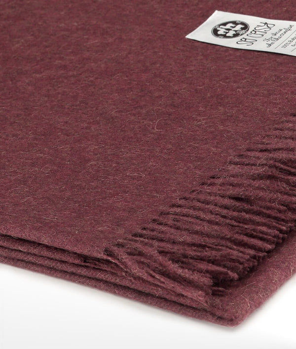 Close up Woven Burgundy Baby Alpaca soft blanket designed in the UK by So Cosy