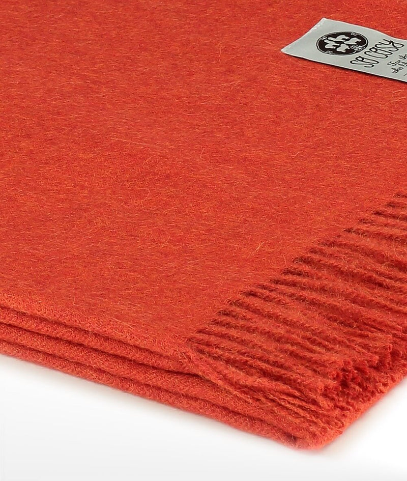 Close up details of woven Burnt Orange Baby Alpaca soft blanket designed in the UK by So Cosy