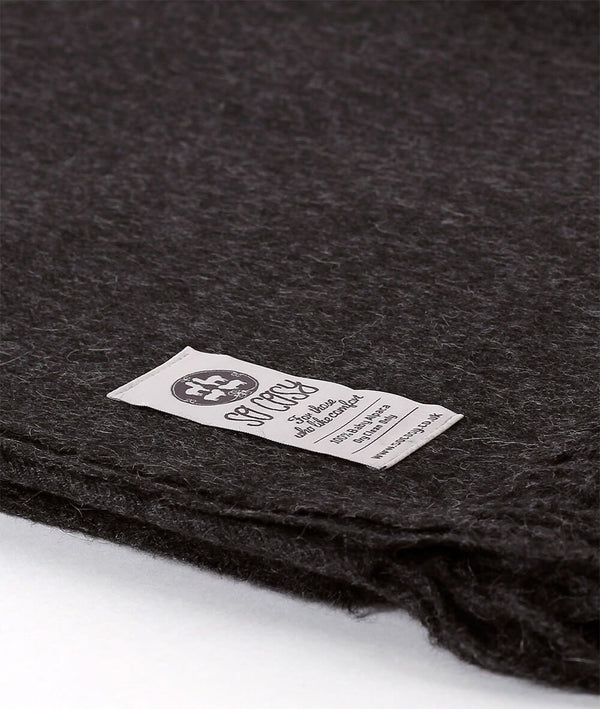 Close up Woven Charcoal Grey Baby Alpaca soft blanket designed in the UK by So Cosy