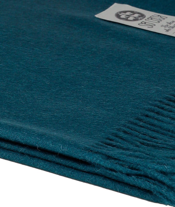Close up Woven Deep Blue  Baby Alpaca soft blanket designed in the UK by So Cosy
