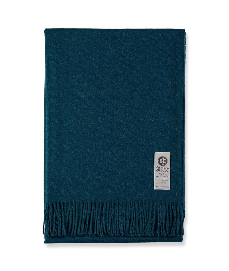Woven Deep Blue Baby Alpaca soft blanket designed in the UK by So Cosy
