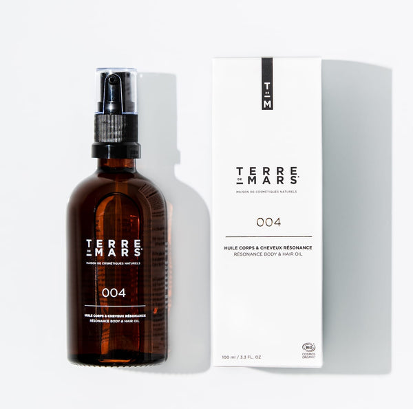 Amber glass and white cardboard packaging of resonance hair and body organic oil by French brand Terre de Mars