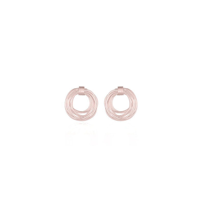 Picture of handmade circle stud earrings designed by East London based brand Keep it Peachy, now available to purchase at Cuemars