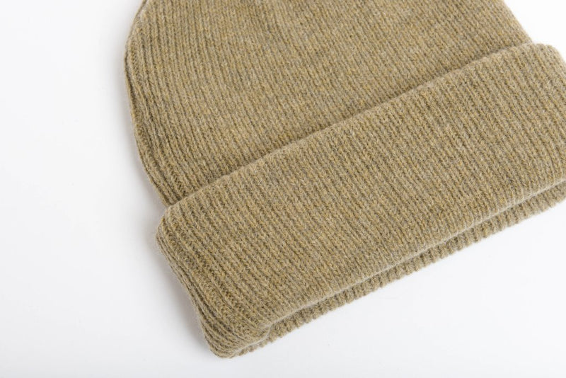 close up details of natural merino wool beanie hat in beige