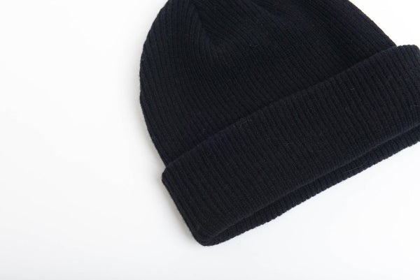 close up details of natural merino wool beanie hat in black