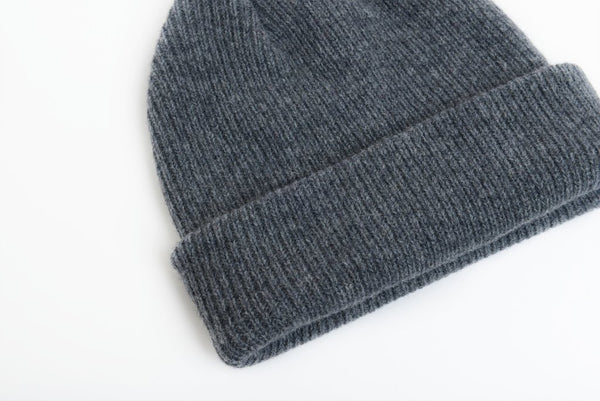 details of natural merino wool beanie hat in dark grey