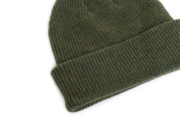 close up details of natural merino wool beanie hat in forest green