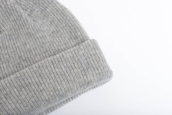 Close up of one sized natural merino wool beanie in light grey