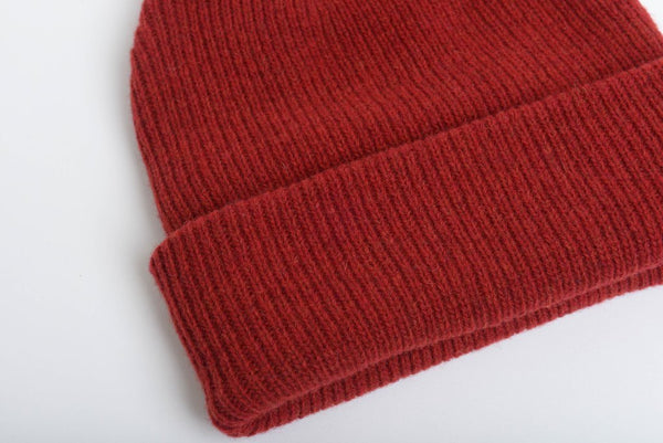 close up details of natural merino wool beanie hat in red