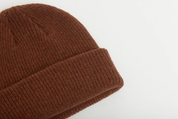close up details of natural merino wool beanie hat in spicy brown