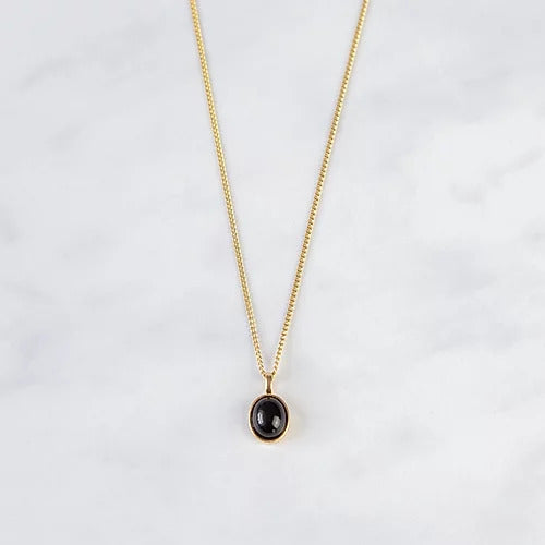 Handcrafted oval black agate necklace in 18ct gold plated recycled sterling silver