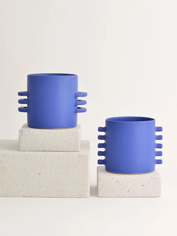 two handmade blue ceramic planters with three horizontal and five peak handles each handmade and handpainted by French ceramist By Laura