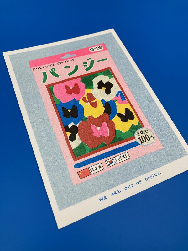 Close up Picture of a Japanese inspired risograph print featuring a package of pansy seeds by Utrecht based We are out of office available now at Cuemars
