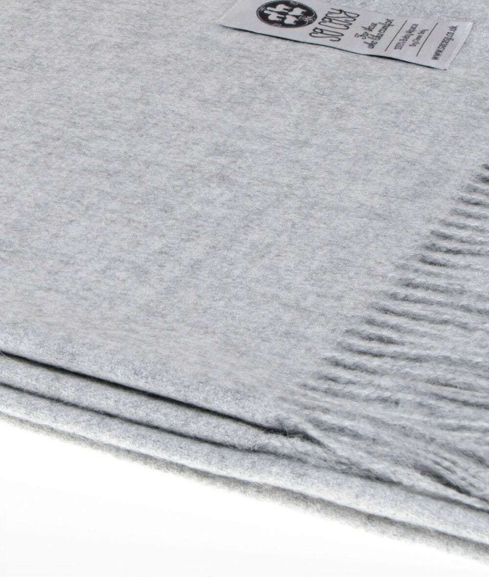 close up picture of handmade super soft baby alpaca throw by so cosy in silver grey available online and at the store