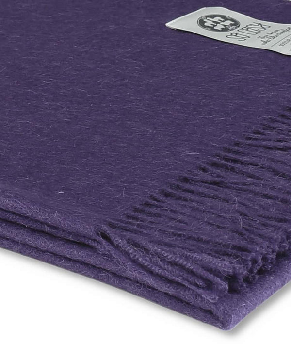 close up picture of handmade super soft baby alpaca throw by so cosy in violet available online and at the store