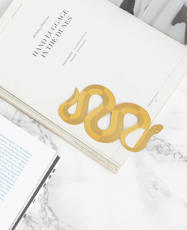 Close up Picture of a finely-cut metal gold snake bookmark by Octaevo available at cuemars.com