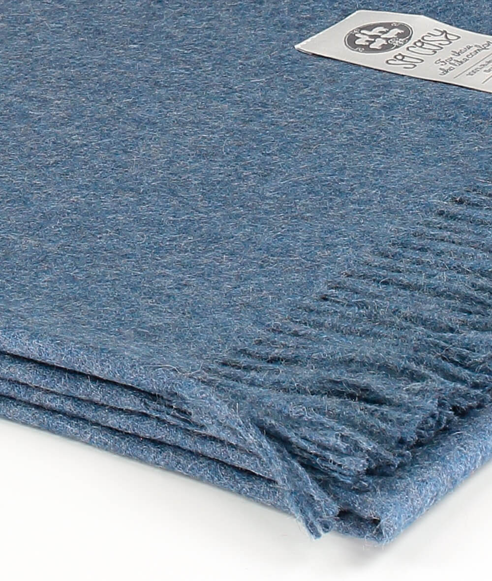 close up picture of handmade super soft baby alpaca throw by so cosy in blue indigo melange available online and at the store