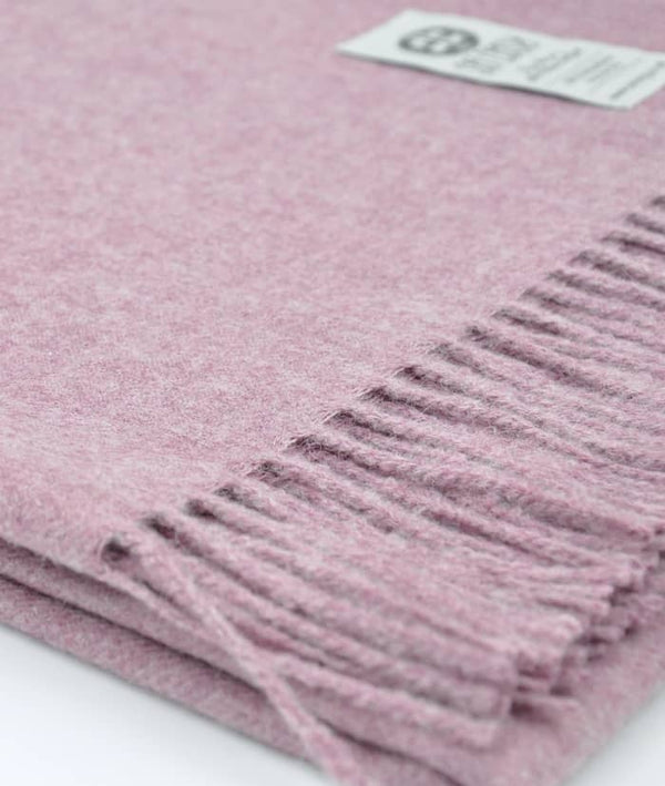 close up picture of handmade super soft baby alpaca throw by so cosy in chalk pink melange available online and at the store