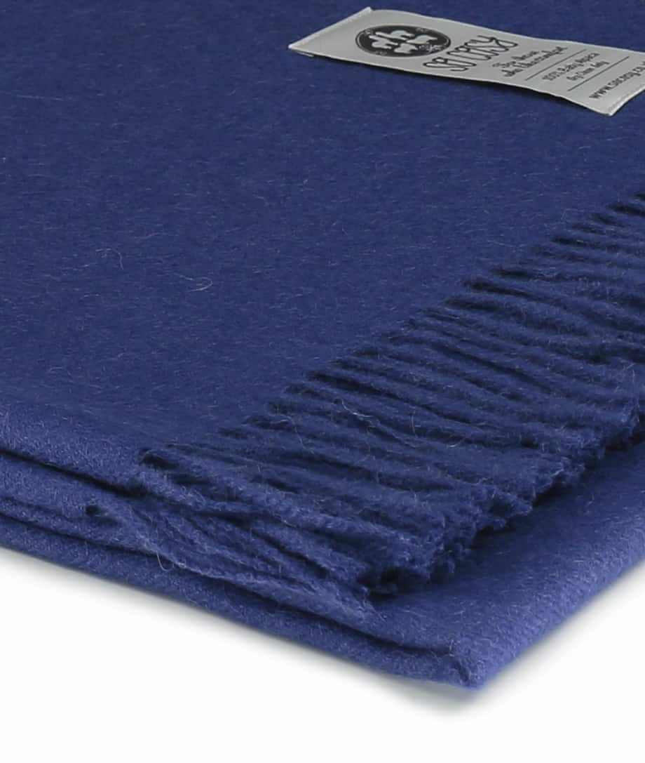 close up picture of handmade super soft baby alpaca throw by so cosy in ribbon blue available online and at the store