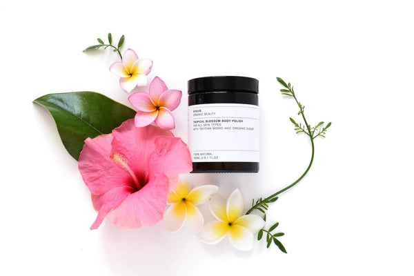 Flat Lay Picture of Evolve Organic Beauty's Tropical Blossom Body Polish available now at cuemars.com