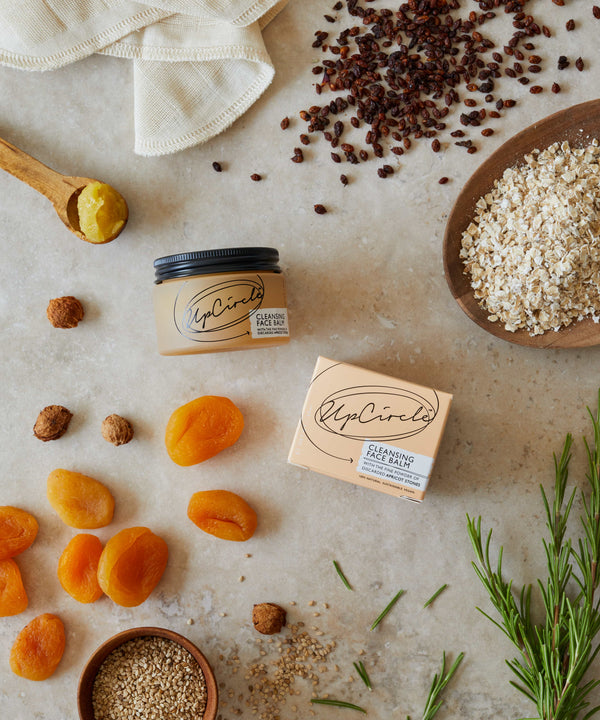 Flat Lay Picture of Natural and vegan cleansing balm made out of apricot stones by upcircle available now at cuemars
