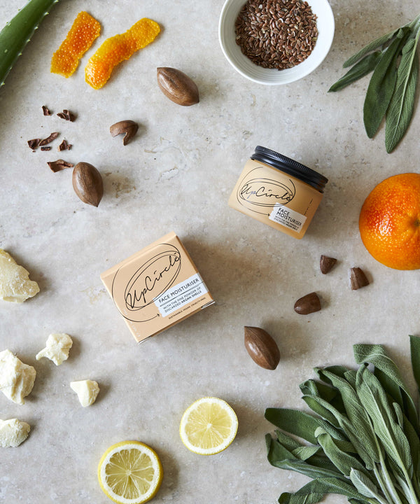 Flat lay Picture of Vegan face moisturiser with ground Argan shells, cocoa butter and blood orange by Upcircle for Cuemars
