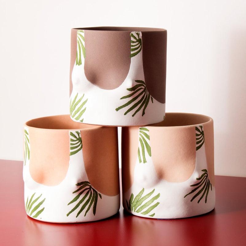 Close up details of Tropical leaves top handmade ceramic plant pot designed by Group Partner