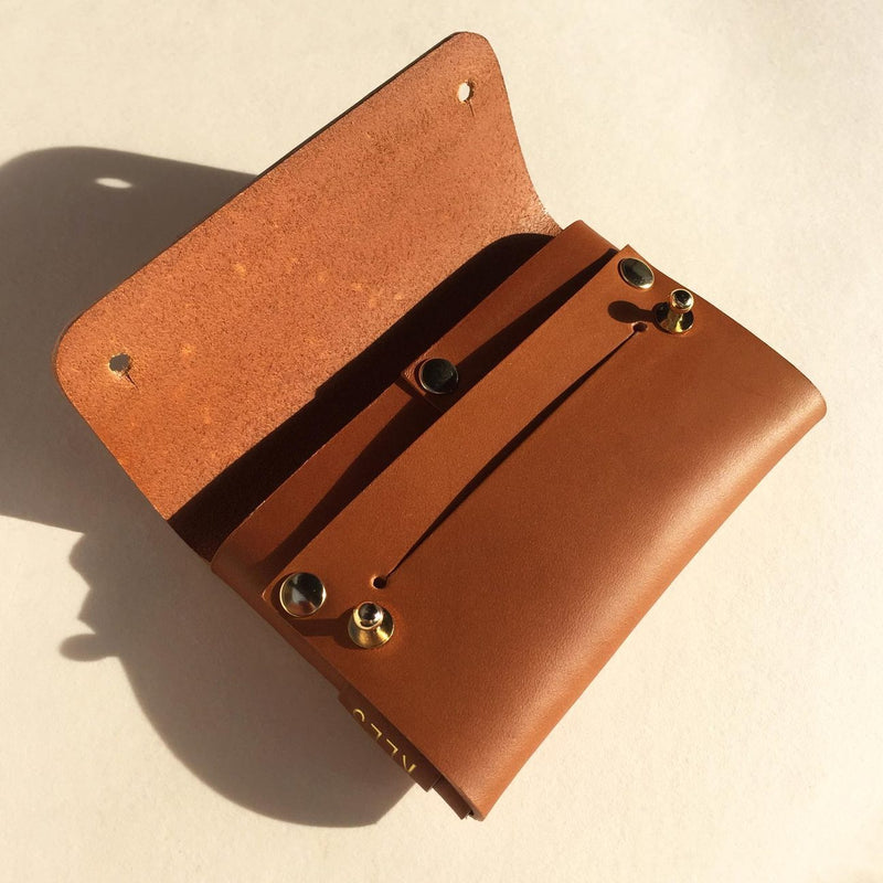 Details of open Vegetable tanned leather brown card wallet by slow fashion UK brand Kles