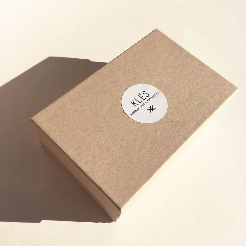 Plastic free packaging for Vegetable tanned leather Ink Brushed card holder by slow fashion UK brand Kles