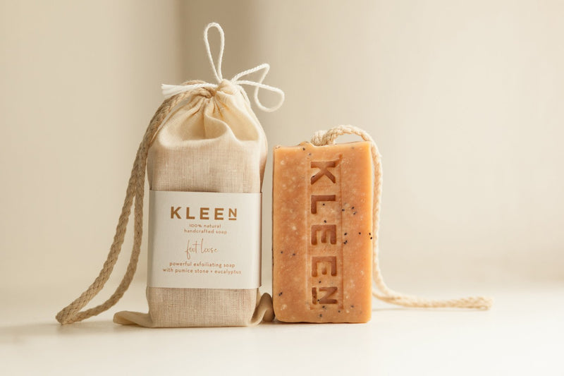 Picture of Pumice foot scrub soap on a cotton rope by natural skincare brand Kleen soaps ideal for tired feet and a cotton travel bag