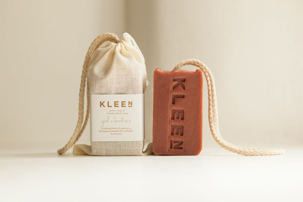 Picture with two French Pink Clay exfoliating soaps on a cotton rope by natural skincare brand Kleen soaps ideal for sensitive skin and a cotton travel bag