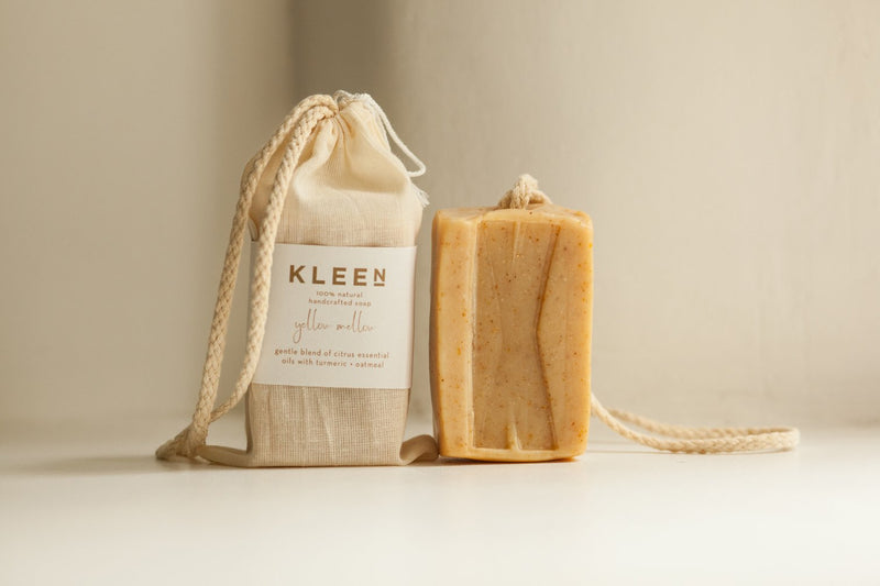 Picture with two citrusy exfoliating soaps on a cotton rope by natural skincare brand Kleen soaps ideal for oily skin and cotton travel bag