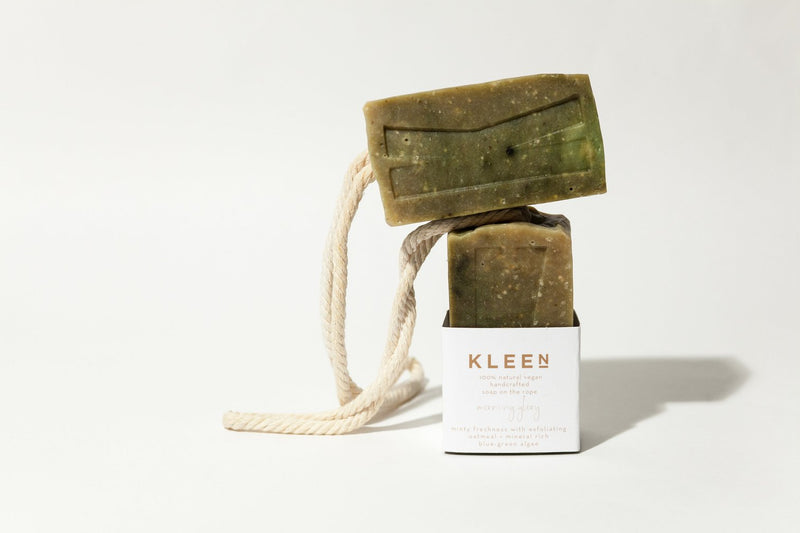 Picture with two Tea Tree oil exfoliating soaps on a cotton rope by natural skincare brand Kleen soaps ideal for oily skin