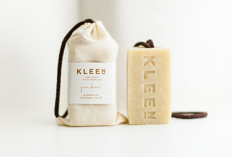 Unscented soap on a cotton rope by natural skincare brand Kleen soaps for sensitive skins and a cotton travel bag