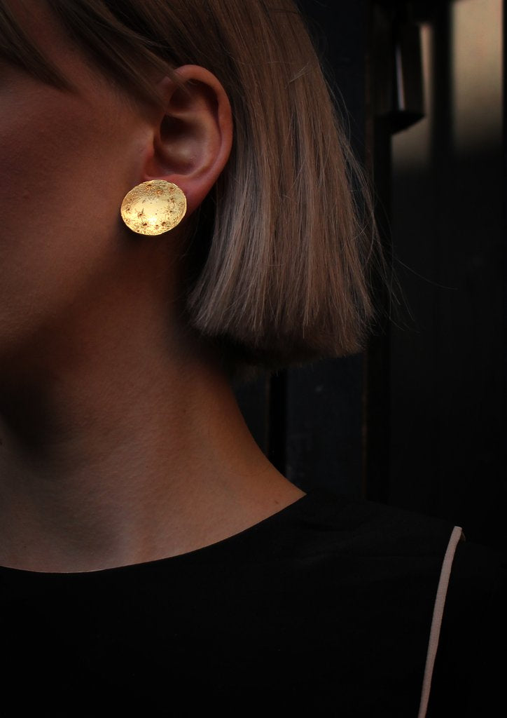 Lifestyle picture of 22ct gold plated Silver Full Moon earrings by Momocreatura