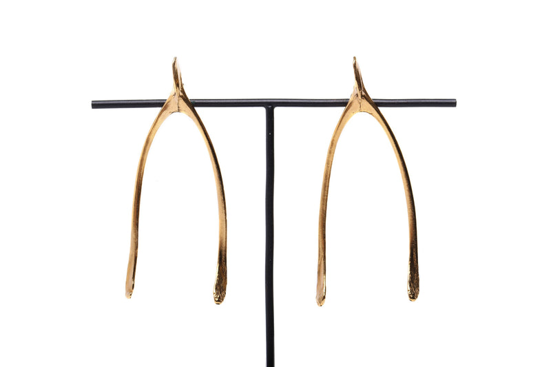 close up details of handmade wishbone earrings in 24ct gold plated silver