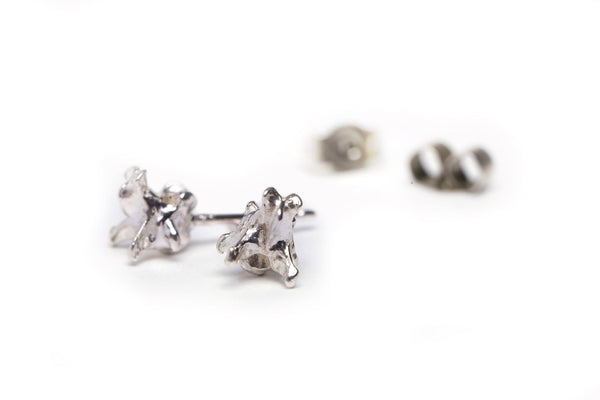 Handmade mole vertebrae ear studs cast in sterling silver by misan jewellery