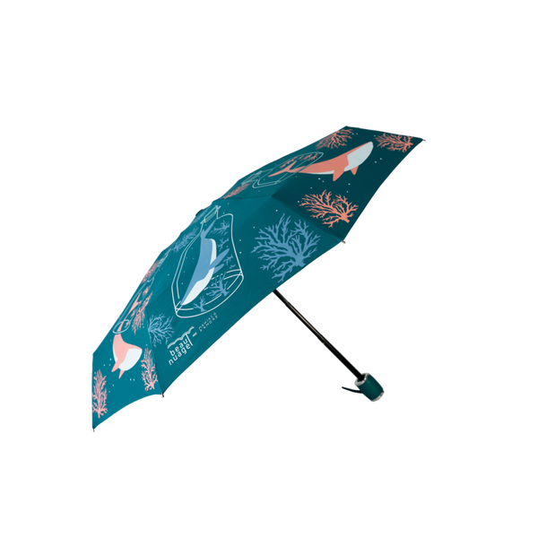 product picture of the Pacific Blue umbrella by French brand Beau Nuage, an umbrella made from recycled plastic bottles aimed to protect our environment as well as keeping us dry from the rain