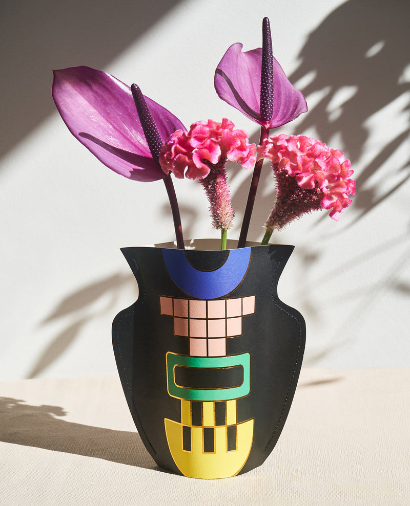 lifestyle Picture of a handmade waterproof mini paper vase by Barcelona based design studio Octaevo with flowers