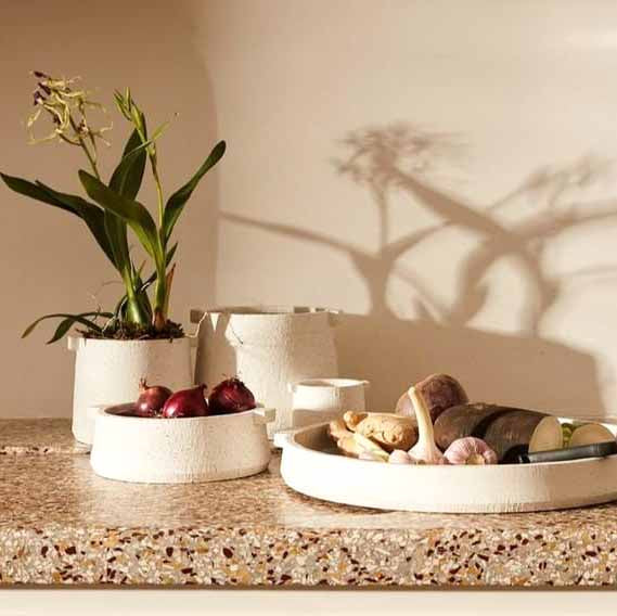 lifestyle picture of ceramic planter raw textured and geometric shaped with two handles
