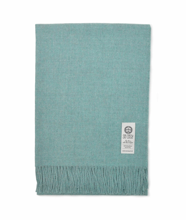 picture of handmade super soft baby alpaca throw by so cosy in pastel blue melange available online and at the store